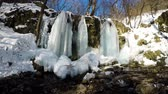 frozen waterfalls : Waterfall in the National Park Slovak Karst, in the village named Haj in winter Stock Footage