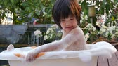 koupání : Cute asian child bathing in the garden