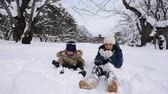 Cute Asian children playing on snow in the park together , Aomori Japan Vídeos
