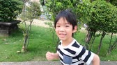 Asian child playing in the park slow motion