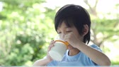 ret : Cute asian child with a glass of milk slow motion