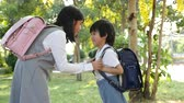 jardim de infância : Cute Asian children going to the school outdoors slow motion