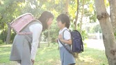 colegio primaria : Cute Asian children going to the school outdoors slow motion