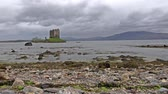 tower : Castle Stalker in Scotland on a stormy day. Stock Footage