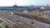 establishing shot : Duisburg, Germany - March 24 2017 : Plant producing steel in Duisburg Huettenheim, aerial time lapse Stock Footage
