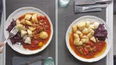 gulash : Top view time lapse of eating a meal with red cabbage, dumplings and gulash