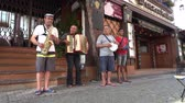 establishing shot : Ruedesheim  Germany - June 22 2017 : Busking musicians demanding more money of the bypassing people
