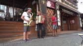 establishing shot : Ruedesheim  Germany - June 22 2017 : Musicians playing their instruments in the public streets
