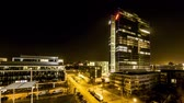 munique : Munich  Germany - February 15 2018 : The Highlight Business Towers in Munich, Bavaria, Germany hosting the companys IBM and Fujitsu - Aerial Time lapse of light giong on and off