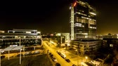 баварский : Munich  Germany - February 15 2018 : The Highlight Business Towers in Munich, Bavaria, Germany hosting the companys IBM and Fujitsu - Aerial Time lapse of light giong on and off