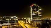 ibm : Munich  Germany - February 15 2018 : The Highlight Business Towers in Munich, Bavaria, Germany hosting the companys IBM and Fujitsu - Aerial Time lapse of light giong on and off