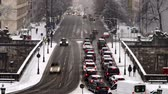 polis : Munich  Germany - February 17 2018 : Traffic is driving through the snow during the snow storm - Aerial Time lapse
