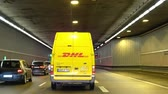 almanca : Munich  Germany - February 16 2018 : DHL van driving through the tunnel