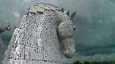 yapılı yapı : Falkirk  Scotland - June 22 2018 - Thunder clouds moving above The Kelpies statue by Andy Scot, Helix park
