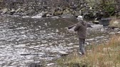 lifestyle : Ogwen Valley  Wales - April 29 2018 : Man fishing in Llyn Ogwen