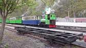 snowdonia : LLanberis, Snowdonia  Wales - May 03 2018 : Steam train standing at The National Slate Museum which is an anchor point of the European Route of Industrial Heritage