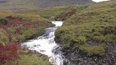 Waterfall at the Quiraing mountain pass road - Isle of Skye, Scotland Stock Footage