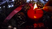 Woman Lighting A Red Christmas Candle Stock Footage