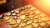 Placing decorations onto freshly baked christmas cookies Stock Footage
