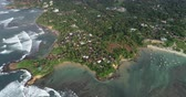スリランカ : Aerial view.Drone ascent aerial footage of ocean waves and weligama cap landscape