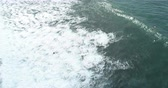 ниже : Aerial view. Aerial drone footage of ocean waves in the morning