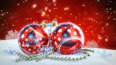 sněhové vločky : red and silver christmas balls on snow with glitter bokeh background. Seamless loop. 3D render