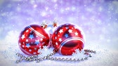 prata : red and silver christmas balls on snow with glitter bokeh background. Seamless loop. 3D render