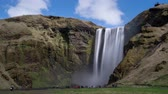 Timelapse of tourist crowds visiting Skogafoss Waterfall