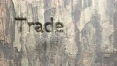 vertical : Animation of Trade marketing words carved in stone wall
