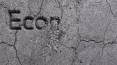 recession : Animation of Economic Crisis words carved in gray stone wall