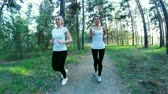 health : young women runnning in park, evening