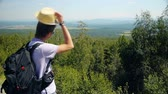 Man hiking and  looking at summer view Wideo