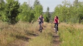 Healthy life: sporty couple riding bicycles  in the forest
