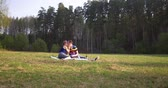 Young couple at picnic. Ultra HD 4K footage