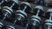 3d animation of camera panning over dumbbells row with blue light