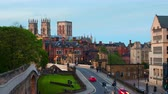 jorkšírský : York, UK. Sundown time-lapse of central York, UK, with York Minster cathedral on the back with cloudy sky