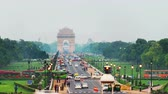 old time : Delhi, India. Time-lapse of Car and people traffic to the India Gate in Delhi in the evening