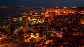 Средиземное море : ALICANTE, SPAIN - JULY 7, 2015: Aerial night view of downtown and harbor. Popular summer resort in Costa Blanca. Old city center with illumination and car light trails. Time-lapse Стоковые видеозаписи