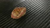 flank : Beef steak is grilling at restaurant kitchen