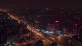 Road junction highway night illumination. Financial District. City road traffic Beijing. Modern architecture skyscrapers. Timelapse from above. China 4K aerial from above. Steel and glass.