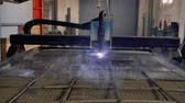 slow motion of plasma cutter. Plasma robotic industrial equipment works with metall sheet.