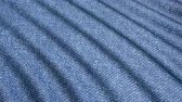 мятый : Movement denim blue material folds. The background fabric in motion.