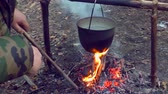 konvice : Pot on fire in the camping. The romance of Hiking by nature. In the camp.