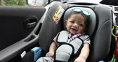baby sitting in car seat safety driving of family travel road trips Vídeos