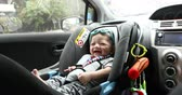 baby sitting in car seat safety driving of family travel road trips Stock Footage