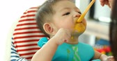 baby eating puree food first time