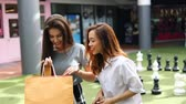 irmãs : beautiful asian women happy shopping time in lifestyle mall