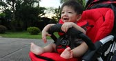 cute boy child sitting happy smile relaxation on baby stroller carriage seat