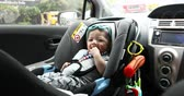 seat belts : baby sitting in car seat safety driving of family travel road trips Stock Footage