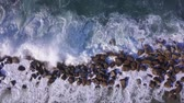 fırtınalı : Ocean waves are breaking on a Breakwater at winter sea. Aerial top down view.